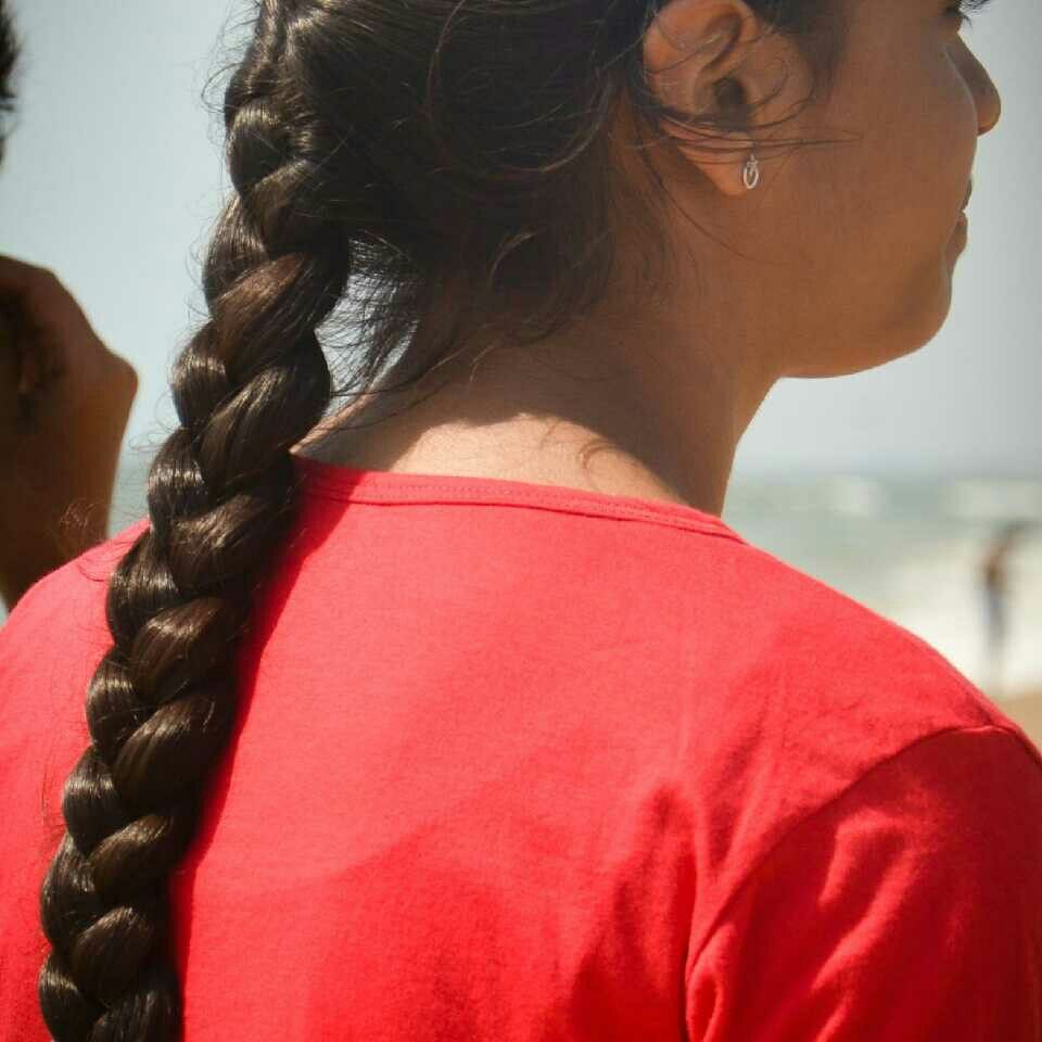 16 year old indian school girl with neat braided hair