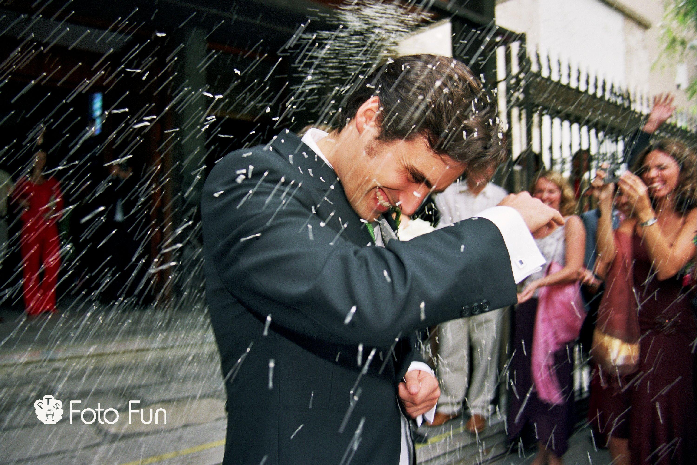 Wedding celebration in Spanish church, people throwing rice. Alberto