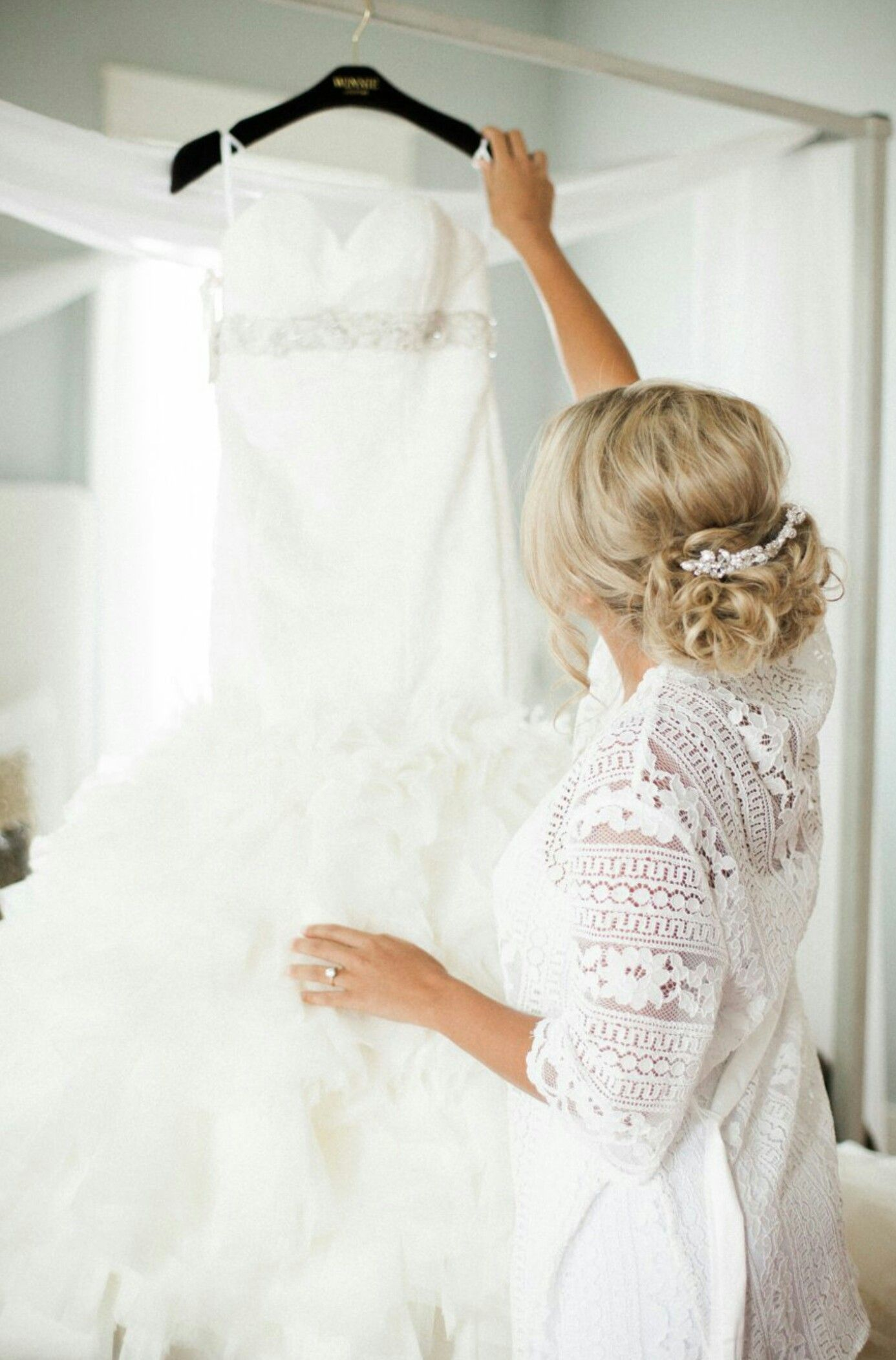 Memory captured of bride holding her dress. I want this