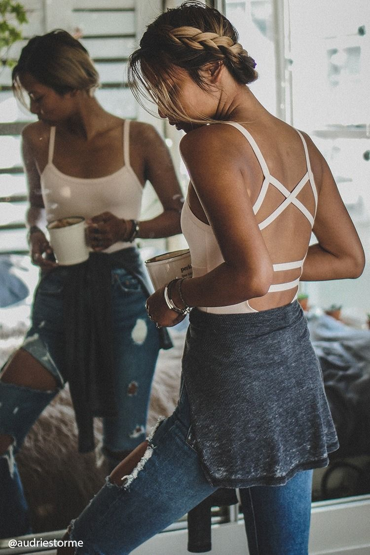 Lace bodysuit with high waisted jeans  An athletic knit bodysuit featuring a strappy cutout back straight