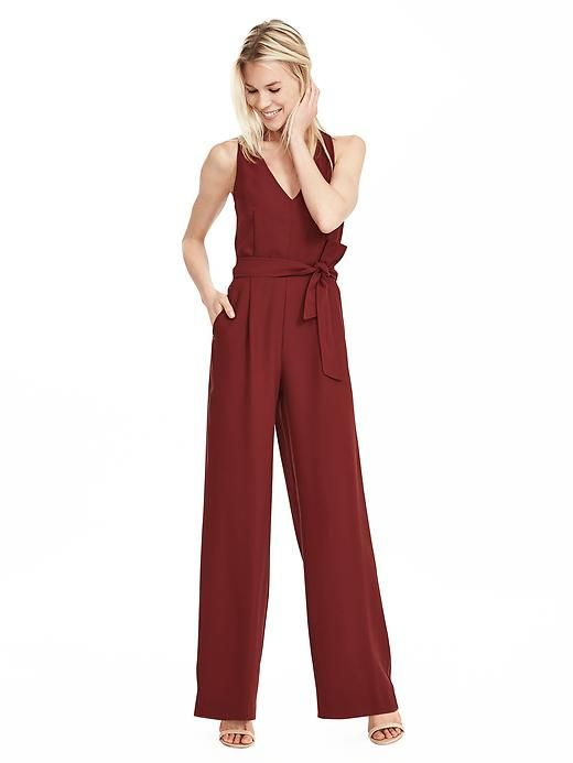 826e125e511 Our chic 70s inspired sleek jumpsuit with a cool cross back detail is the  perfect piece to elevate your effortlessly chic style