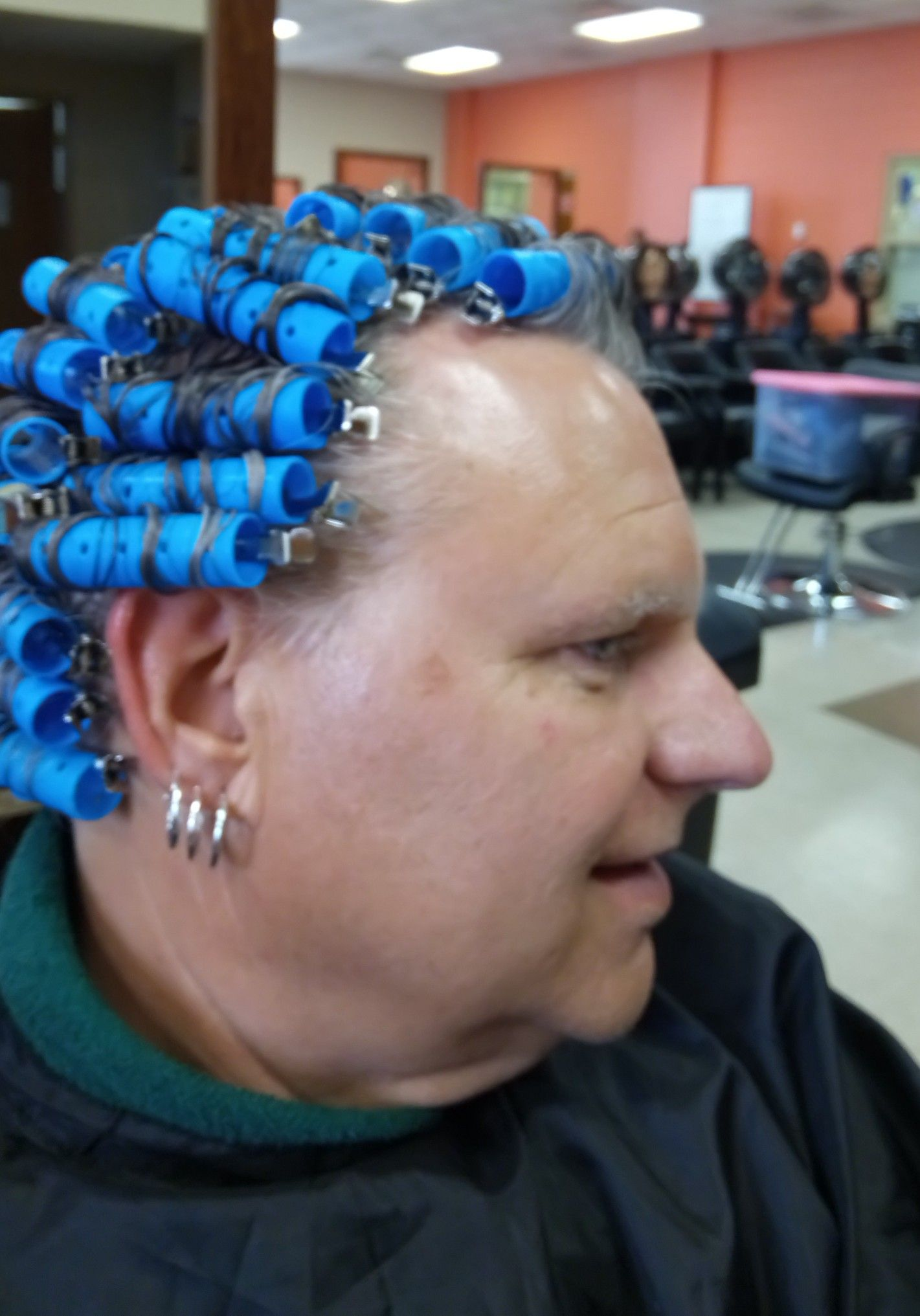 sissy boy in hair rollers pin on beauty salon curlers
