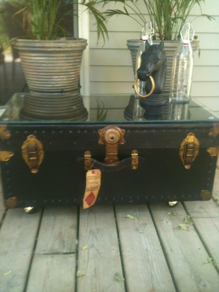 Antique steamer trunk relined castor wheels and glass for Interesting coffee table tops