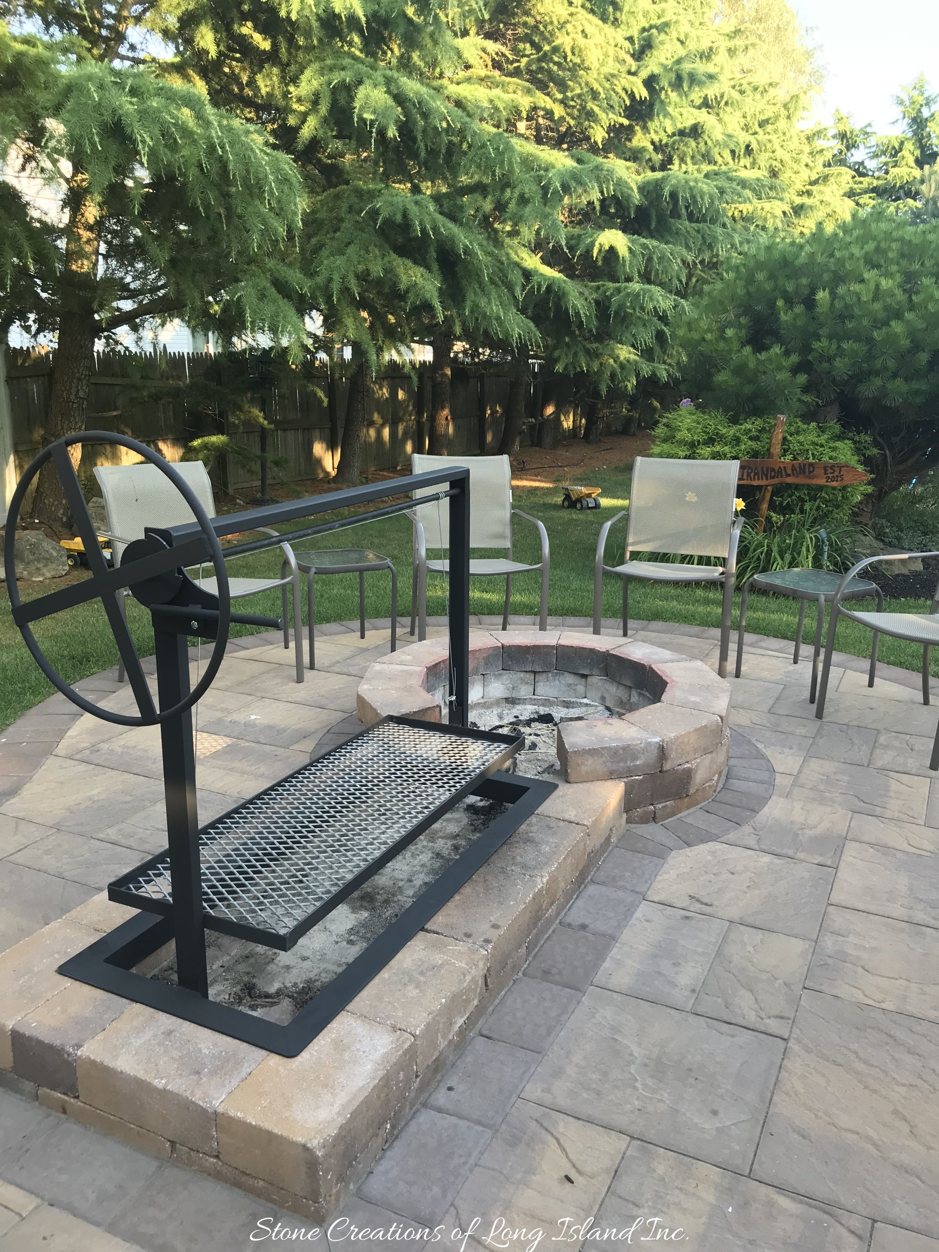Argentinian Parilla Grill Built With Cambridge Pavers For Wood Or Charcoal Grilling Adjustable Grill Slanted Backyard Bbq Pit Fire Pit Backyard Fire Pit Bbq