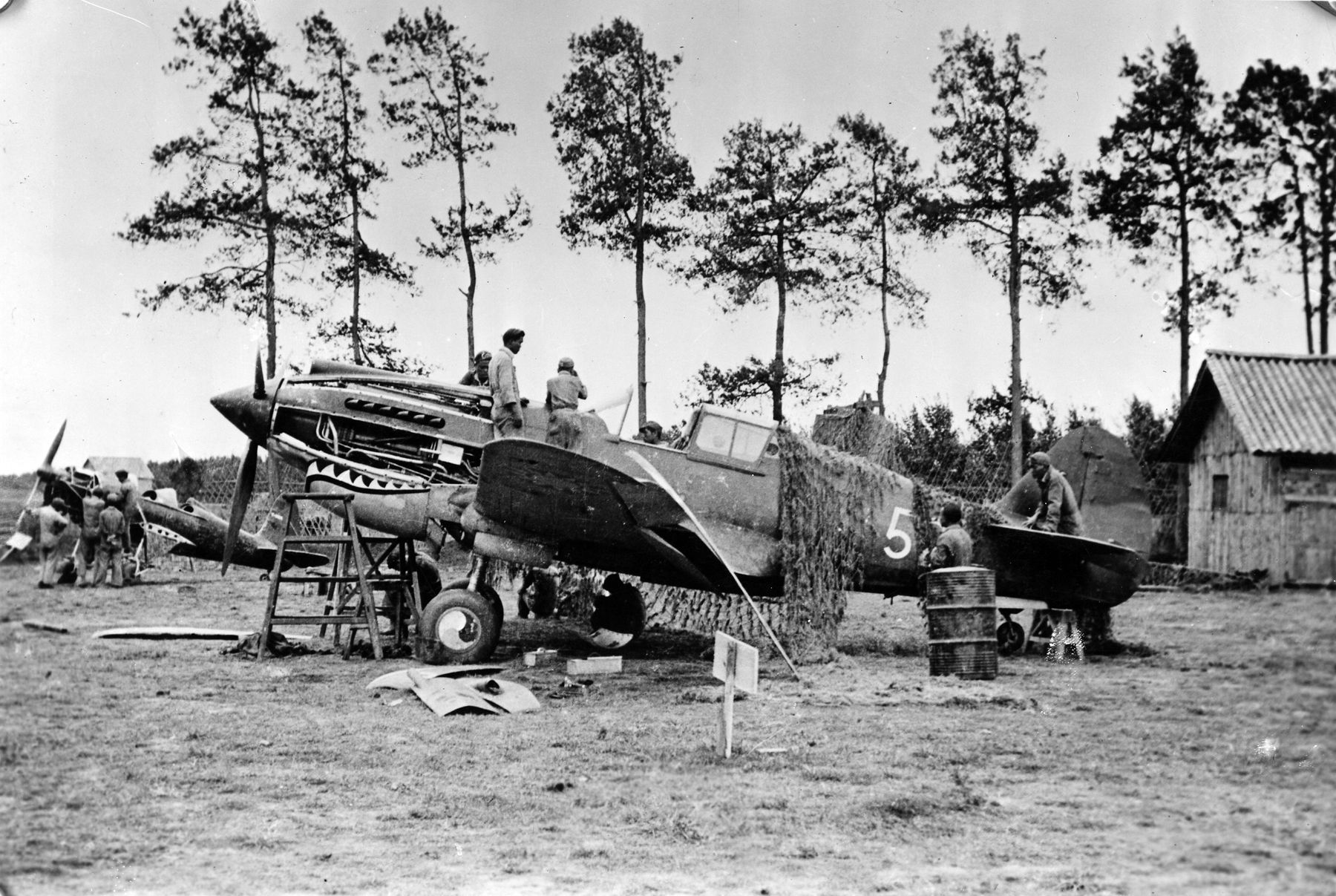 Repairing a Flying Tiger P40 at Kunming, China. (U.S. Air