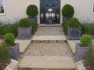 Boxwood balls of increasing size leading to front door | Landscape ...