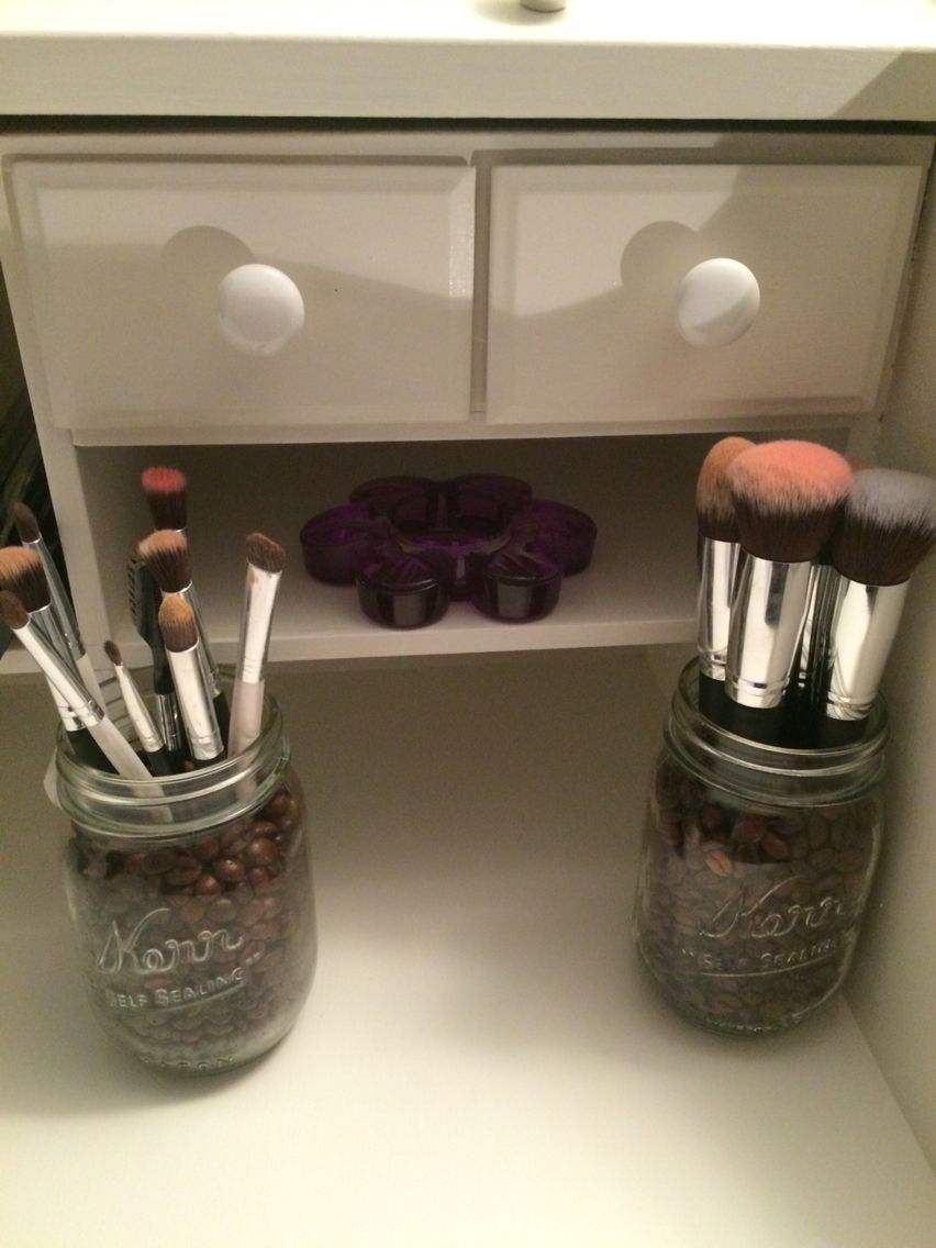 Mason jars full of bulk coffee beans it holds the makeup brushes