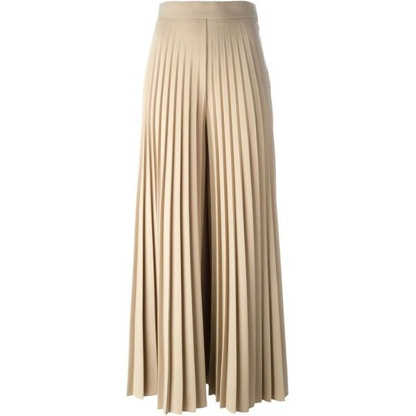 See this and similar Givenchy pants - Beige wool blend pleated trousers  from Givenchy featuring a wide leg, a high rise and a side button fastening.
