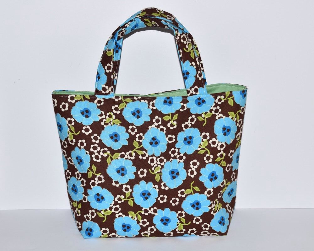 Women's Handbag, Tote Bag, Handmade Bag, Contains Pocket & Magnetic Button Closure, Bold Floral Pattern, Bag for Everyday Use, Cute Tote Bag by RachelMadeBoutique on Etsy https://www.etsy.com/listing/267993676/womens-handbag-tote-bag-handmade-bag