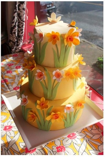 Three tiers covered in yellow fondant and gum paste daffodils. Made for the Point Arena Flowers Power & Daffodil Festival!