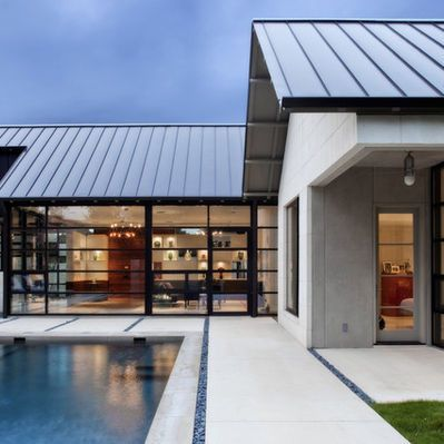 Black paint metal roof metals and modern for Modern metal homes