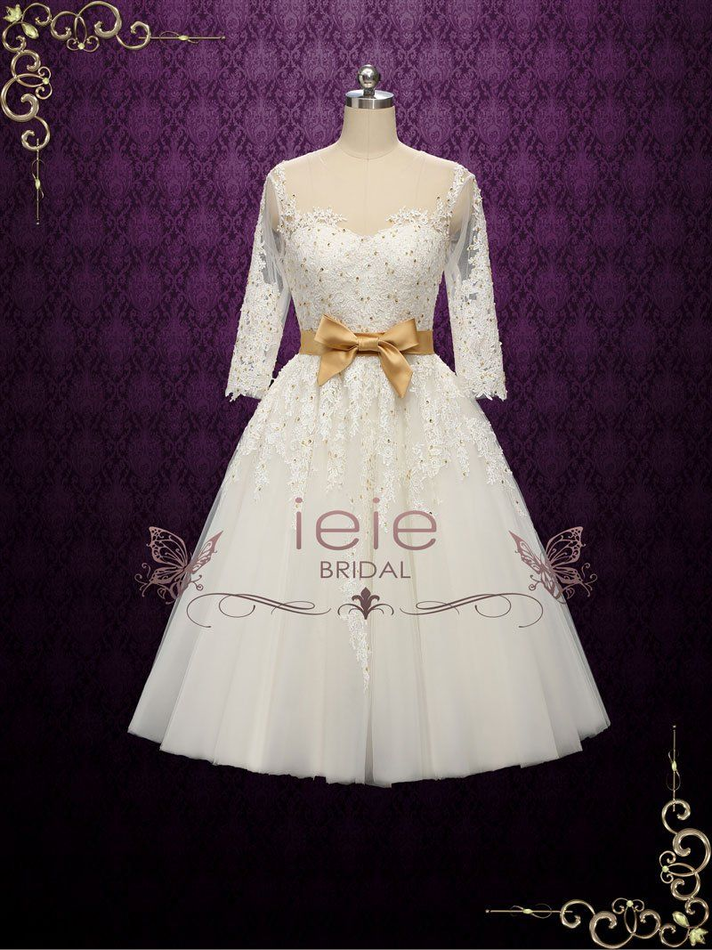 Vintage style lace tea length wedding dress with gold accents