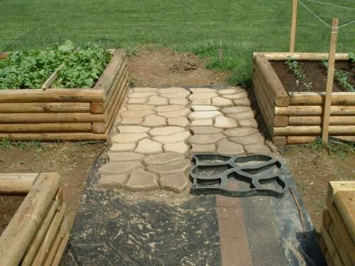 Concrete pathes in raised garden beds