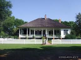Cherokee Plantation is an example of an early French Creole plantation house It is elevated six feet off the ground on brick piers The timbers are hand hewn cypress and the walls are filled with bousillage made from Spanish moss animal hair and mud from Cane River The exterior of the house is covered with wooden siding and the interior bousillage walls are painted white It is believed that the house was built in 1839 It is open during the Fall Tour of Homes in Natchitoches