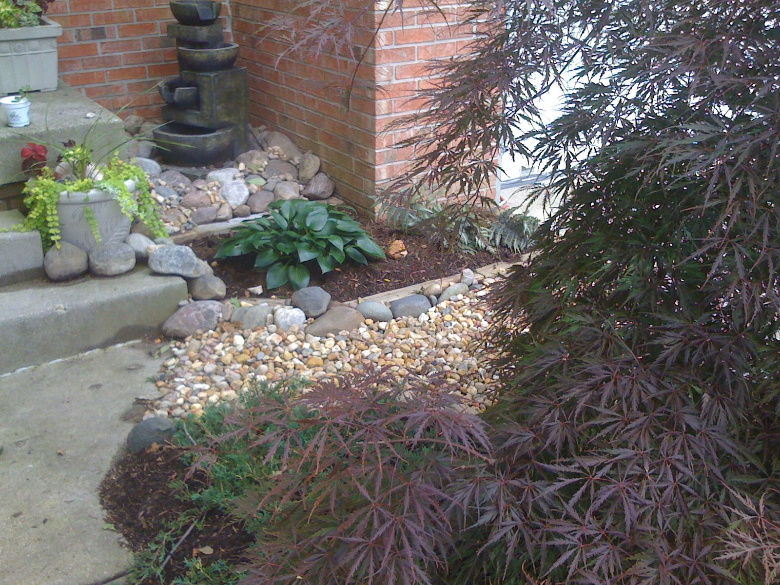 Landscaping details in very small spaces are fun and inexpensive