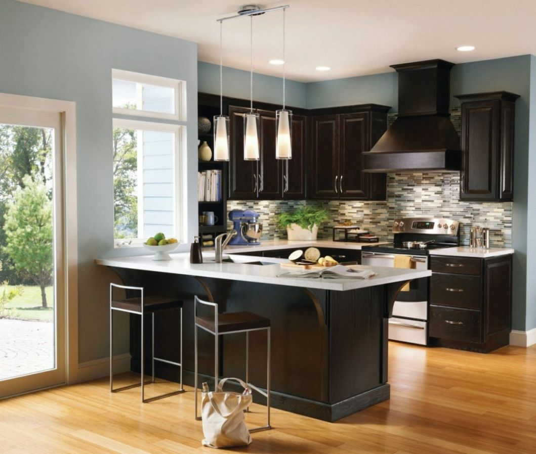 A Contrasting Kitchen Pairs Espresso Cabiry Design Meet In 2020 Espresso Kitchen Cabinets Kitchen Cabinets Home Depot Small Kitchen Decor