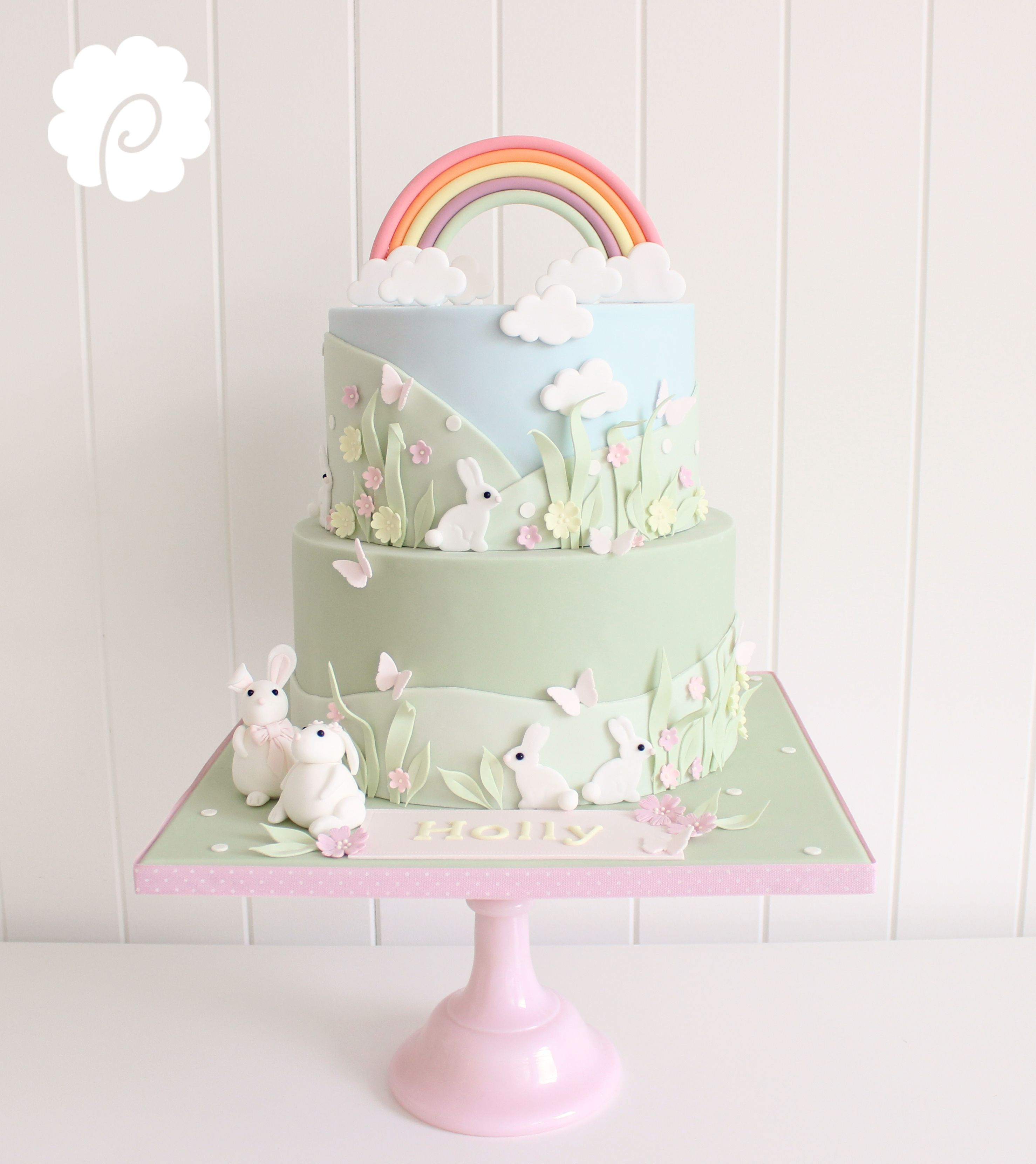 Pastel colour rainbow and bunnies themed christening cake