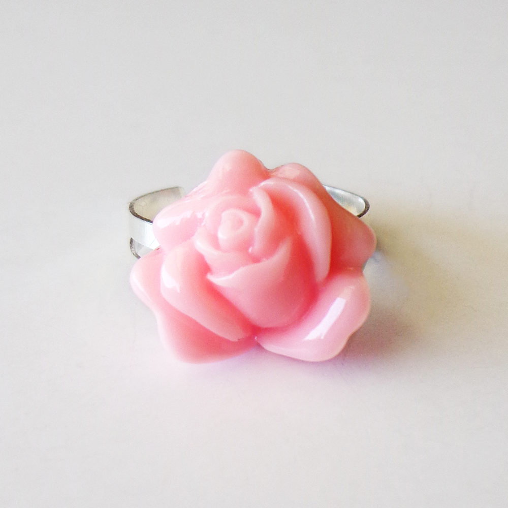 Handmade ring with a pink rose charm. Features: Adjustable On Trend ...