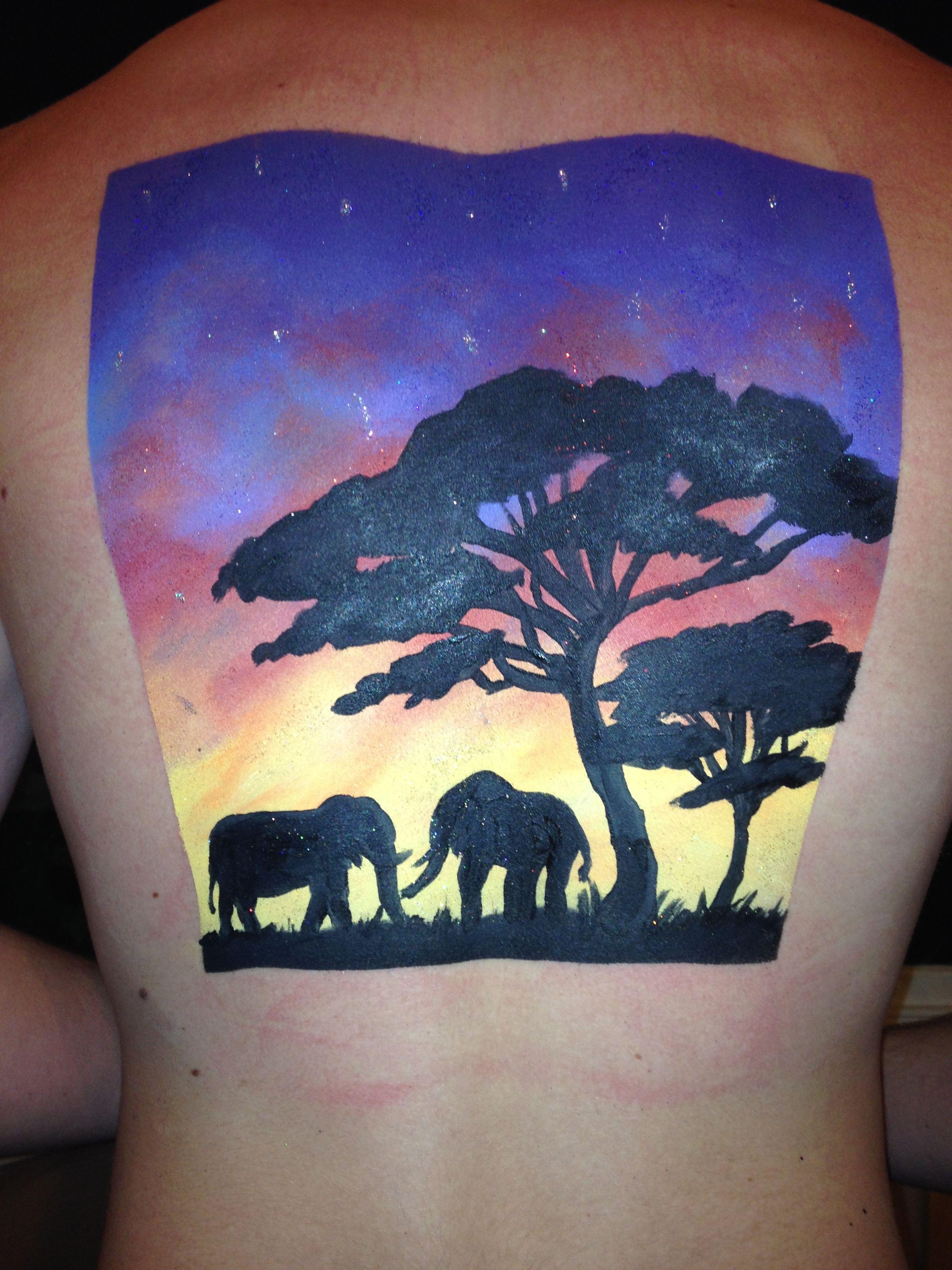 Facepaint on the back, African sunset silhouette