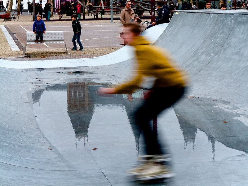 Museumplein, Amsterdam, The Netherlands, December 2013 - January 2014, Roller blading over reflection of the Rijksmuseum
