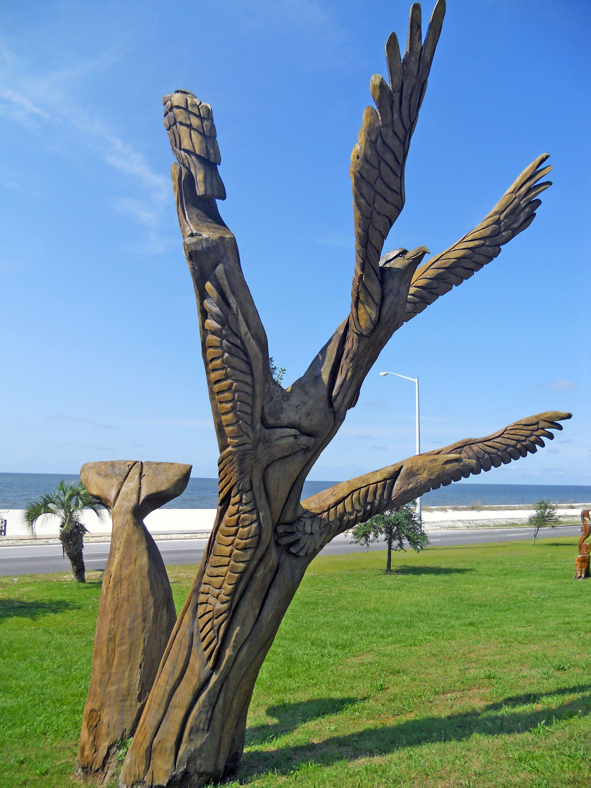 Katrina sculptures whale tail osprey located in biloxi
