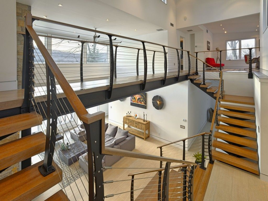 Double Interior Staircase With Stainless Cable Railing System.