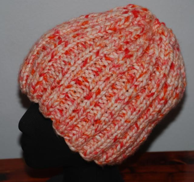 Flat hats are a great way to make a quick project without the worry of having to work with circular and/or double-pointed knitting needles. This ribbed hat has a little bit of shaping at the top for a snug fit and is perfect for cool days.