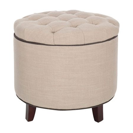 Wrapped in beige upholstery, this chic ottoman's button-tufted top lifts to reveal hidden storage.  Product: Ottoman      ...