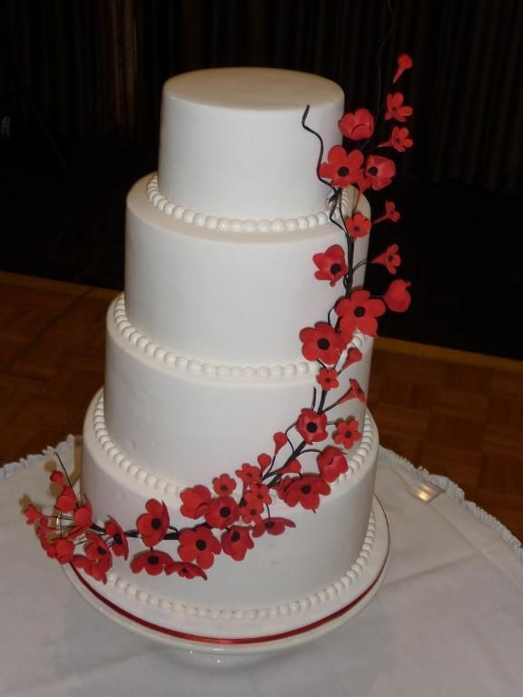 Red cherry blossom wedding cake--  Being a cherry blossom fanatic, of course I LOVE this one!