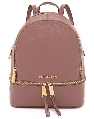 8de3ba79559e Rhea backpack by MICHAEL Michael Kors. A structured MICHAEL Michael Kors  backpack in pebbled leather. Polished logo lettering accents th.
