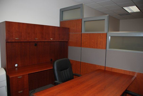 Transitional inwood executive desk with coordinating partial glass partial laminate staggered privacy wall in the connecting elements columbia sc office