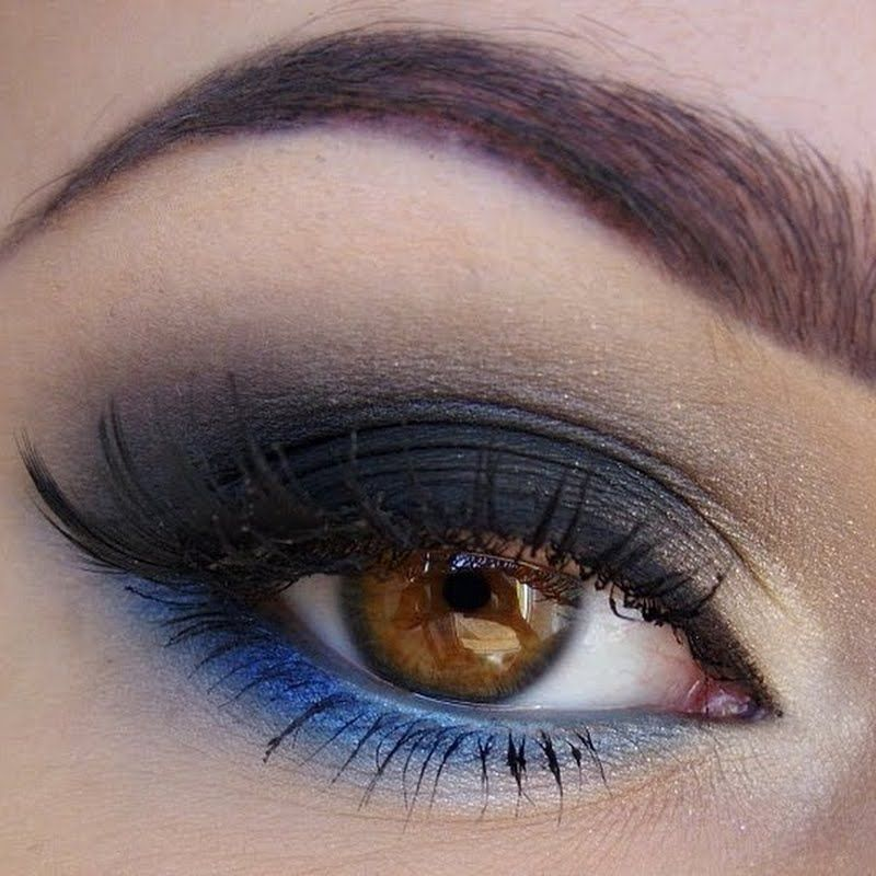 Add a swipe of royal blue eyeshadow along the lower lash line to ...