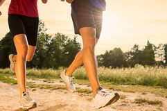Young Couple Jogging in Park Royalty Free Stock Image