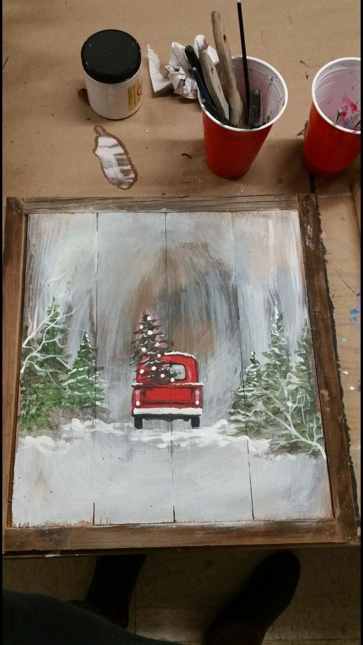 Painted red truck with a Christmas tree on wood