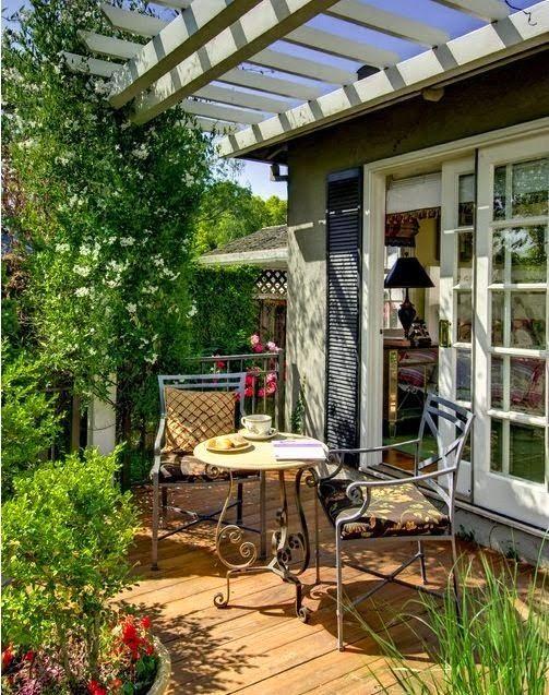 Cottage style back patio and pergola