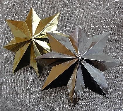 Eight Pointed 3-D Metallic Stars - Easy, cheap craft that uses craft-grade aluminum foil, some patience, and a ruler.