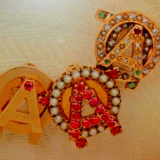 Badges in a display case at AOII HQ