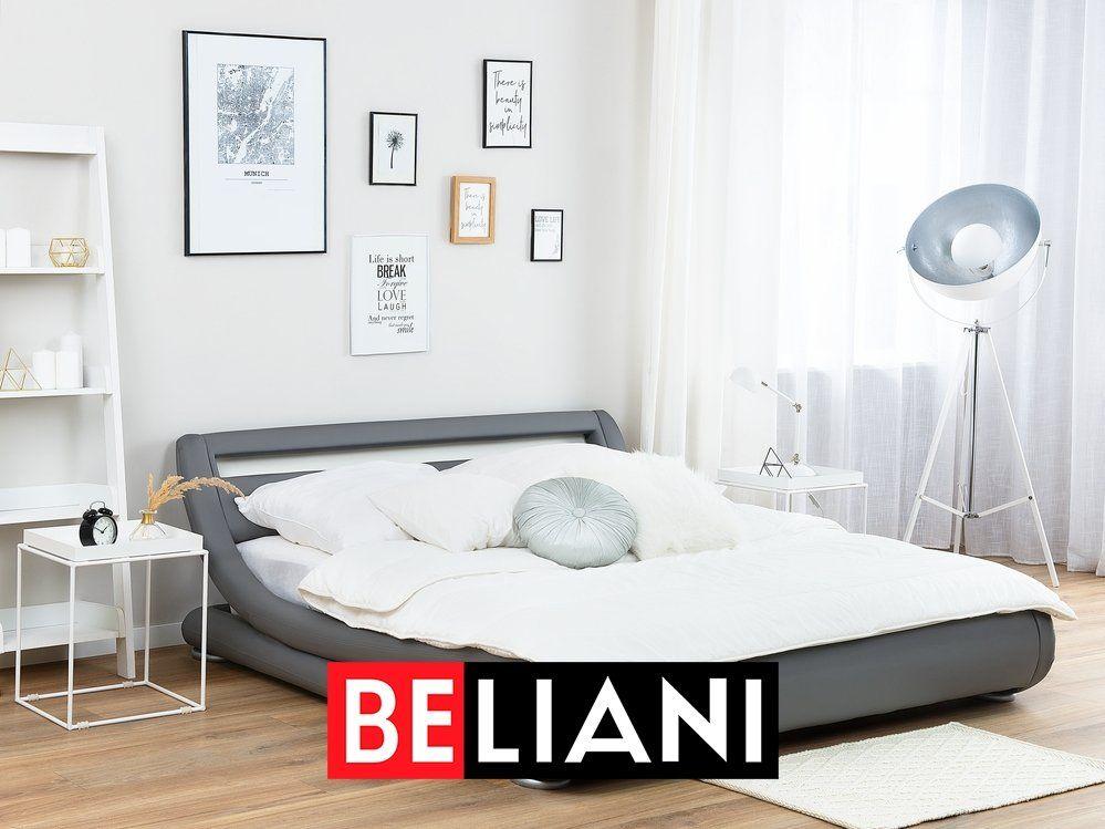 Photo of Elegantes Designerbett aus grauem Kunstleder mit integrierter LED Beleuchtung