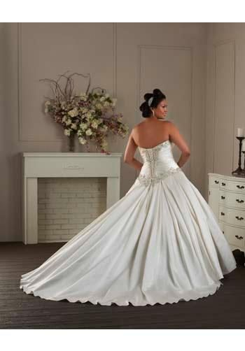 An exquisite ball gown in rich satin. The strapless bodice features a sweetheart neckline and flattering ruching while crystals and rhinestones frame out the entire bodice. Layering box pleats created the voluminous skirt and train. Finished with a lace-up back.