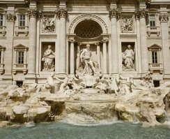 The Trevi fountain, the largest baroque fountain in Rome, was completed in 1762. The fountain is 85 feet high, and 65 feet wide. Marble statues of the tritons guide God Neptune's shell chariot, taming