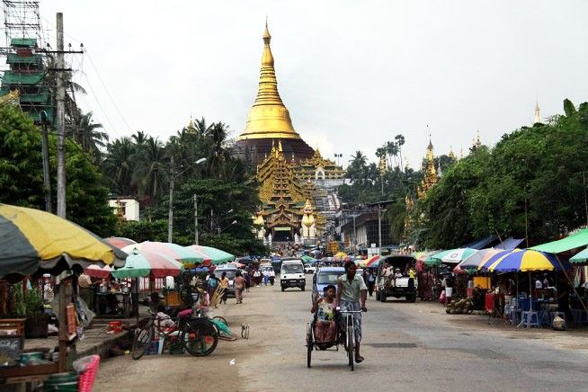 Trishaws are still a common sight in Yangon. Pic: Jo Lane/Visited Planet.
