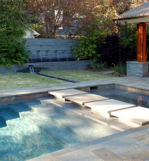 Modern Pool Floating Step Pads Fountain Spills Into Pool