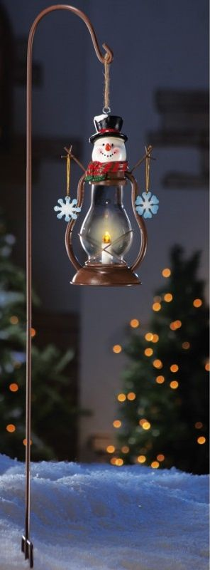 Solar powered LED light hangs from a staked metal shepherd\u0027s hook - solar christmas decorations