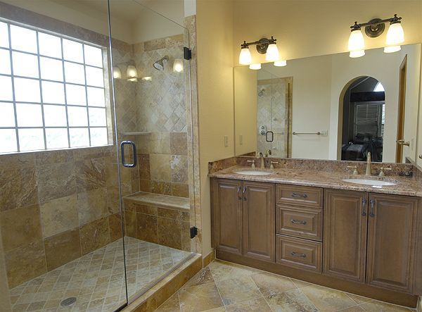 The Art Gallery A travertine tile master bathroom remodeling project with double his and her shower a shower