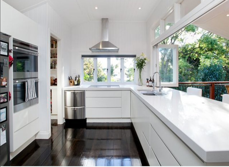 Kitchen Open Bifold Windows And White Cupboards With White Benches Walk In Pantry Modern Queenslander Kitchen Home Kitchens Kitchen Design