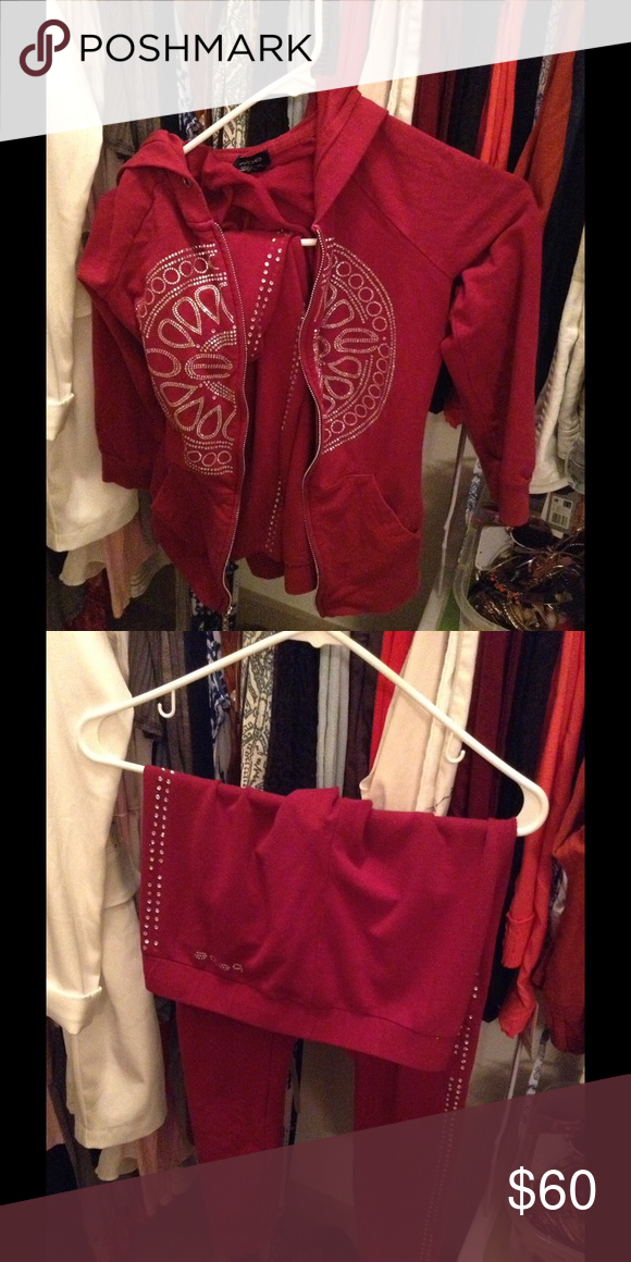 Bebe sweat suit Gently used pants are missing a few stones down the leg but doesn't look bad when worn bebe Other