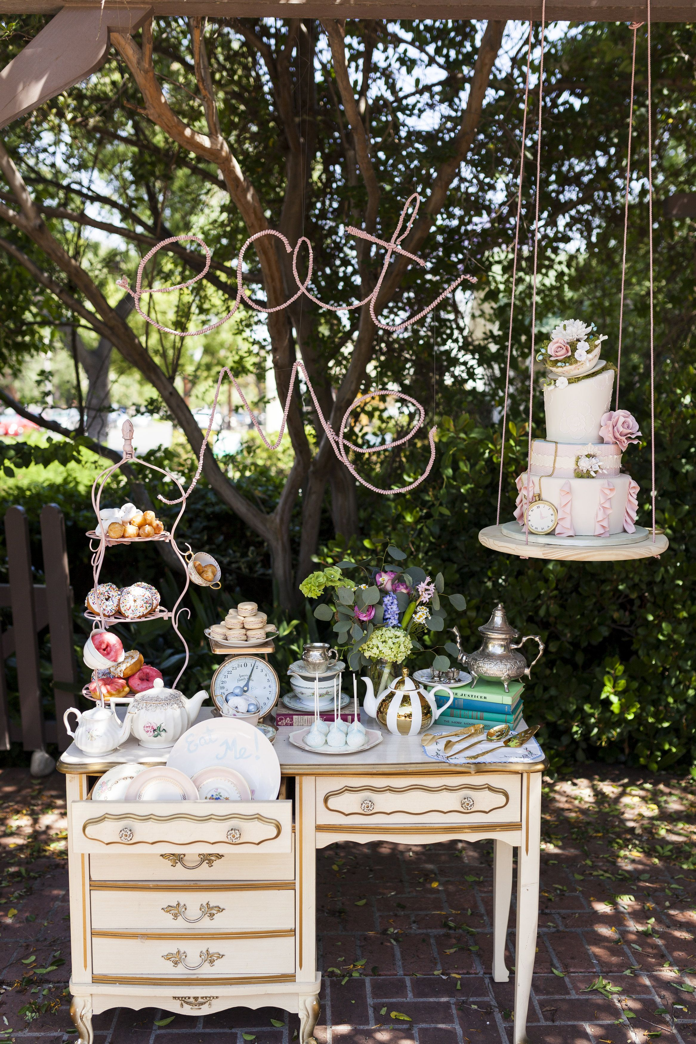 Outdoor garden wedding decoration ideas  Whimsical Dessert Table With Floating Cake  Décoration Gourmande