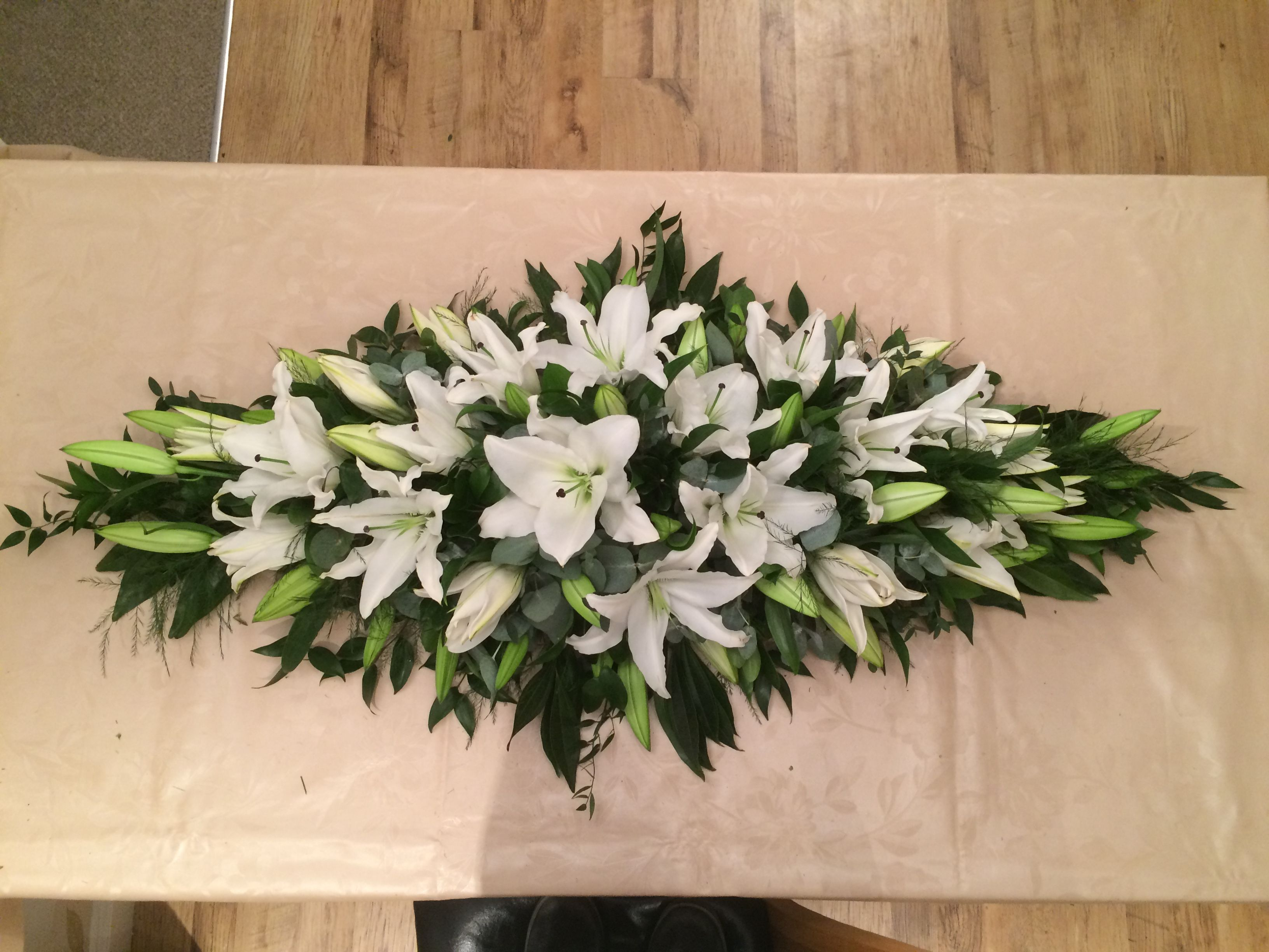 White Lily 4 Funeral Coffin Spray created by Willow House Flowers Ayle