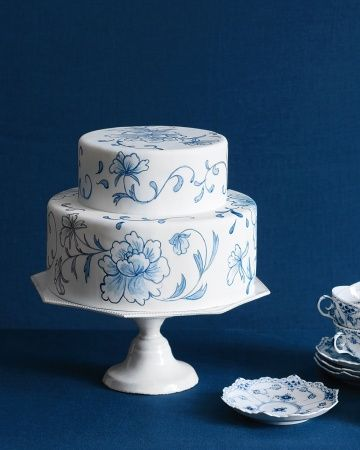 Blue hand-painted flowers embellish a white fondant cake