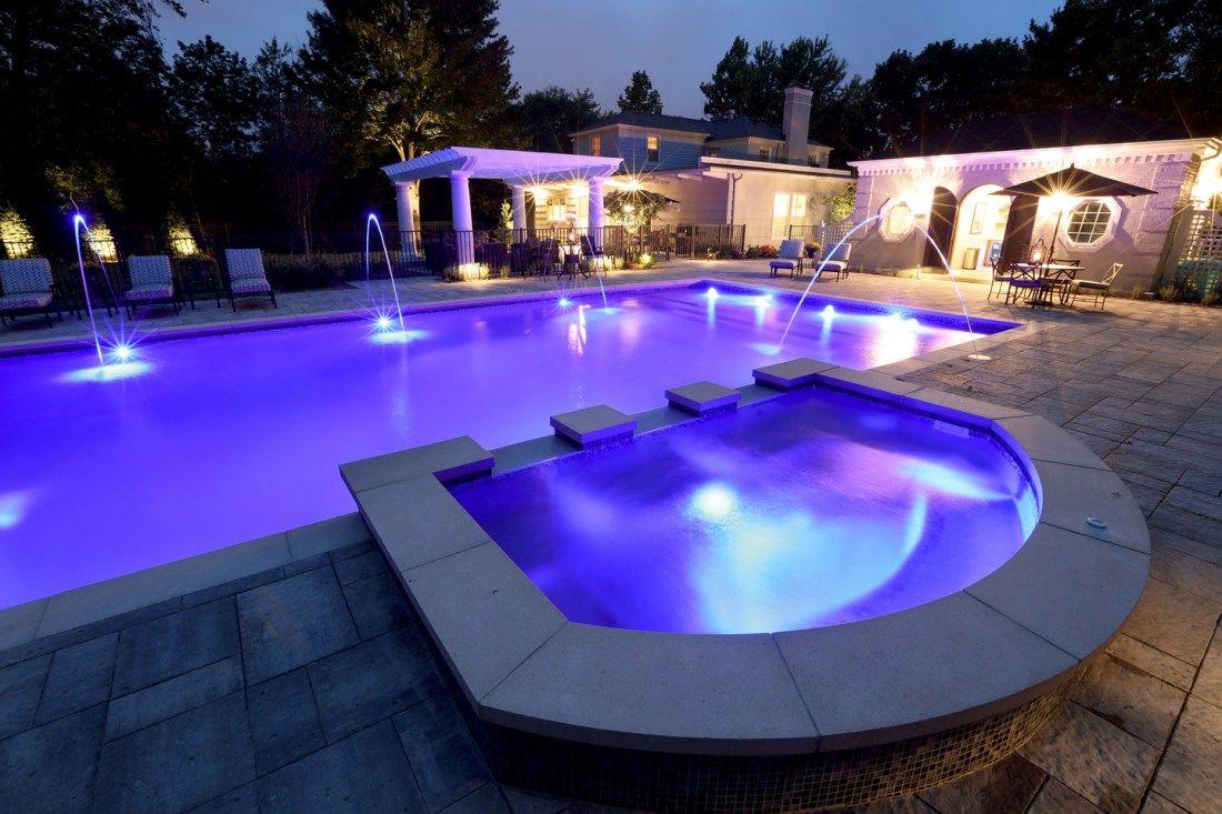 Led Pool Lighting That Would Make Prince Proud By Signature Pools Mi Pool Colors Led Pool Lighting Floating Pool Lights
